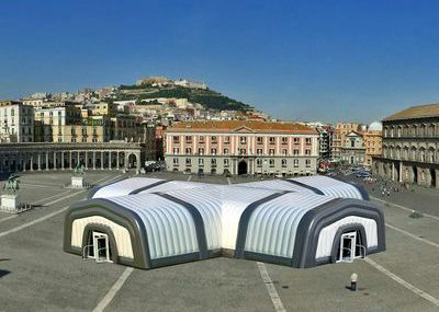 Inflatable roof structures joined together to make a main event structure