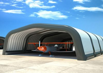 Inflatable stage cover used as an inflatable aircraft hanger